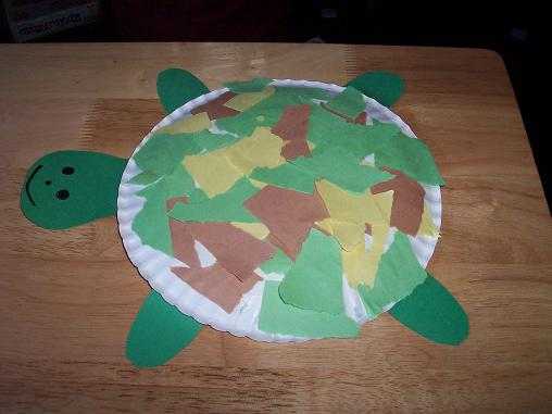 Gluing the torn pieces onto the paper plate. : paper plate turtle - pezcame.com